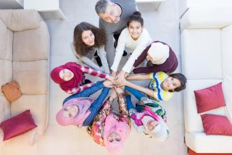 Muslim modern family with hands together