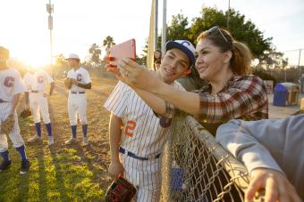 Mother and baseball player son taking selfie