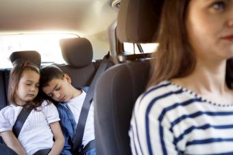 Single mom driving and siblings sleeping in the car