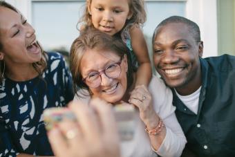 happy multi-cultural family on porch