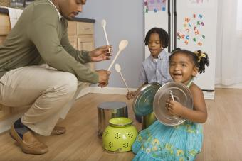 Family playing pots and pans like drums
