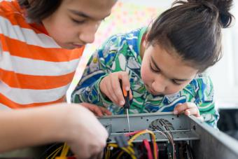 Two children working with electronic equipment