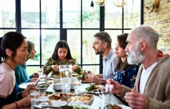 three generation family enjoying dinner together