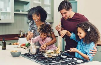family of four cooking together