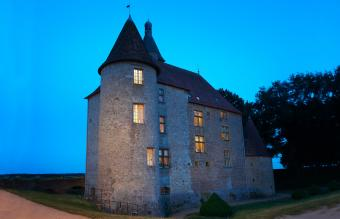 Stone house lit up at night