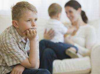 Young boy jealous of infant sibling