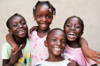 Several children smiling and hugging