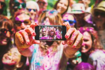 Group of friends taking a selfie together during a Holi celebration party