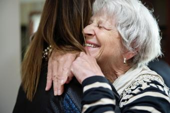 Grand-mother and adult grand-daughter hugging