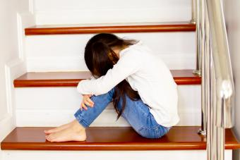 Child crying on the staircase