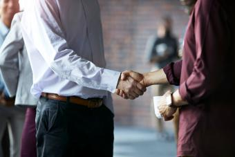 Businessmen handshake at conference
