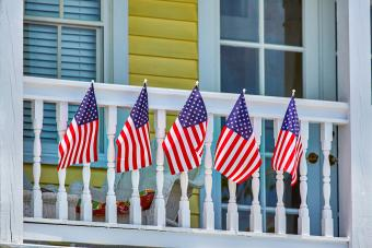 American Flag draped on balcony of house