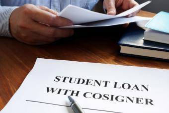 Student loans with cosigner application form and pen