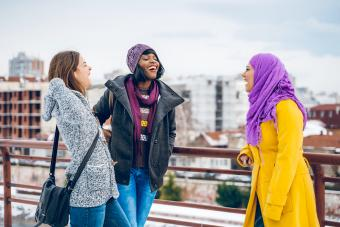 Multi-ethnic group of female friends are chatting during winter walk