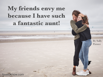 Aunt and niece hugging on a beach and proud aunt quote