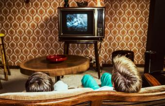 watching television at home in 60's style