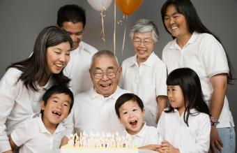 grandfather celebrating birthday with family