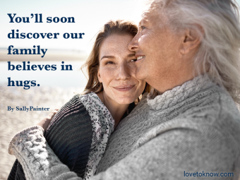 Young and older woman hugging and a welcome to the family quote