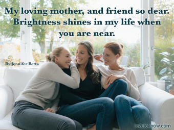 Happy mother with two teenage girls on couch at home and Mother's day poem