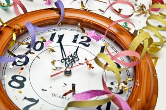 Clock covered with confetti and ribbons