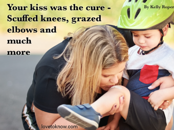 Mother kissing child's injured knee after falling down from a bicycle and Mother's day poem