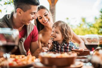 Young family enjoying meal