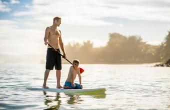 Stand Up Paddle Boarding father and son