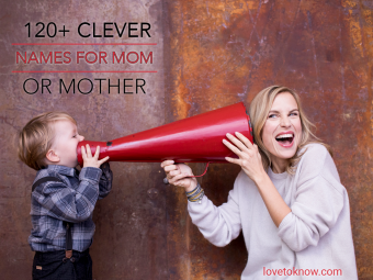 Young boy speaking into megaphone in mom's ears