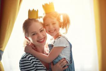Mother and child daughter wearing crowns