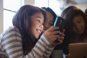 Mom and daughter using cell phone