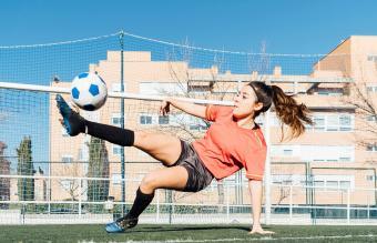 Young girl playing football