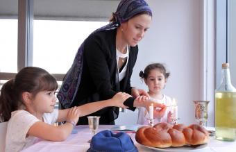 Jewish family light Sabbath candles