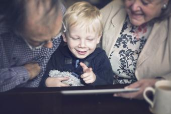 Happy child and Grandparents using a tablet