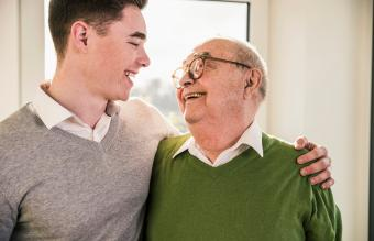 Senior man smiling at young man