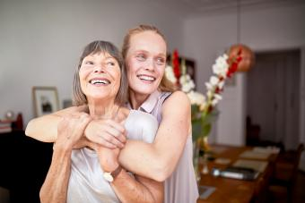 Cheerful mother and daughter at home