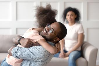 Happy dad embracing daughter