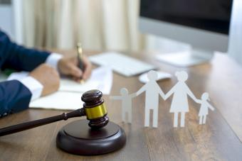 Family figure and gavel on wooden table