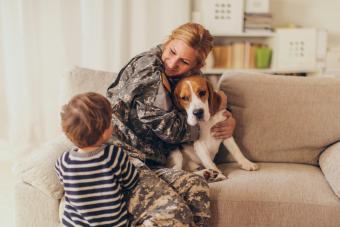 Welcome home mommy soldier with puppy