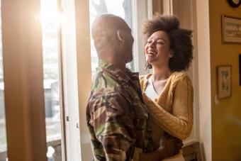 Cheerful woman talking to her military husband
