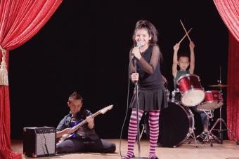 Siblings performing on stage