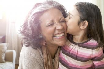 Granddaughter kissing cheek of grandmother