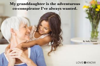 Granddaughter hugging her grandmother in living room