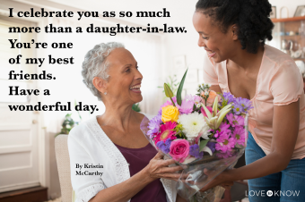 Woman giving daughter in law a bouquet of flowers