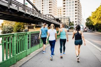 Fitness Group Cooling Down After City Run