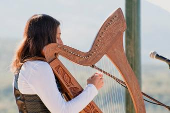 Woman playing Irish harp