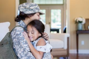 Young girl is happy to see army mom