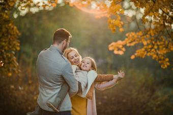 family having fun in autumn season at the park