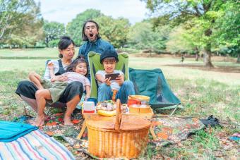 Family having picnic in public park
