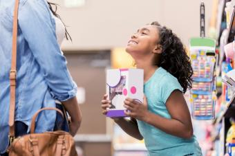 Little girl begs her mom to buy a toy
