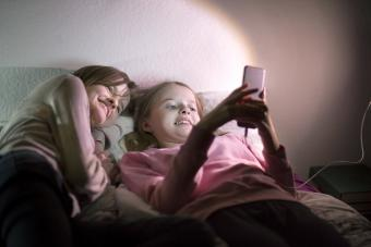 Two sisters using a mobile phone